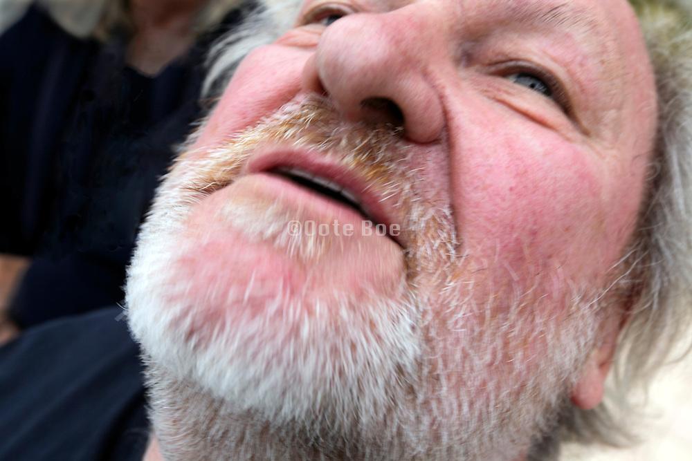 face of an adult man with graying beard