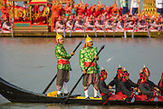 06 NOVEMBER 2012 - BANGKOK, THAILAND:  Oarsmen on a Thai Royal Barge propel the boat down the Chao Phraya River in Bangkok for the dress rehearsal for the Royal Barge Procession. Thailand's Royal Barge Procession has both religious and royal significance. The tradition is nearly 700 years old. The Royal Barge Procession takes place rarely, typically coinciding with only the most important cultural and religious events. During the reign of King Bhumibol Adulyadej, spanning over 60 years, the Procession has only occurred 16 times. The Royal Barge Procession consists of 52 barges: 51 historical Barges, and the Royal Barge, the Narai Song Suban, which King Rama IX built in 1994. It is the only Barge built during King Bhumibol's reign. These barges are manned by 2,082 oarsmen. The Procession proceeds down the Chao Phraya River, from the Wasukri Royal Landing Place in Bangkok, passes the Grand Palace complex and ends at Wat Arun. Tuesday's dress rehearsal was the final practice for the 2012 Royal Barge Procession, which takes place November 9.     PHOTO BY JACK KURTZ
