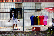 Sayda Raphael, 24, of Nayarit, Mexico hangs clothes out to dry after hand washing them. Raphael works at the farm with her husband while their two children live in Mexico.