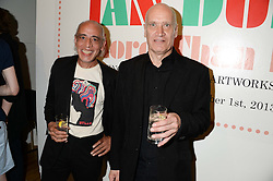 Left to right, NORMAN WATT-ROY the bassist for The Blockheads and singer-songwriter WILCO JOHNSON at a private view of the late Ian Dury's artwork entitled Ian Dury: More Than Fair – Paintings, drawings and artworks, 1961–1972 held at the Royal College of Art, Kensington Gore, London SW7 on 22nd July 2013.