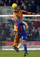 Photo: Chris Ratcliffe.<br />Crystal Palace v Wolverhampton Wanderers. Coca Cola Championship. 10/12/2005.<br />Micheal Hughes (bottom) of Palace and Jolean Lescott compete for a header