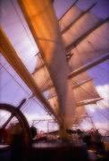 Looking up at the giant sails of a clipper ship, sailing off the coast of Italy