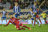 Max Ehmer (Gillingham) sends the ball goalwards during the Sky Bet League 1 match between Wigan Athletic and Gillingham at the DW Stadium, Wigan, England on 7 January 2016. Photo by Mark P Doherty.