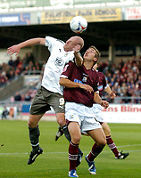 Photo: Richard Lane.<br />Northampton Town v Bristol City. Coca Cola League 1. 29/08/2006. <br />City's Steve Brooker gets above Luke Chambers to head the ball.