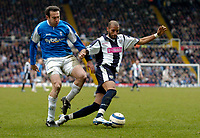 Photo: Richard Lane.<br />Birmingham City v West Bromwich Albion. The Barclays Premiership. 11/03/2006. <br />West Brom's Diomansy Kamara breaks past Stan Lazaridis.