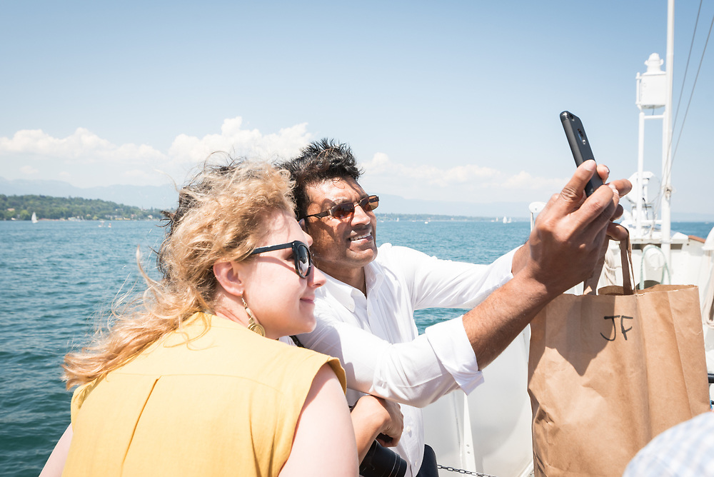 """1 July 2018, Geneva, Switzerland: Following Sunday service at the Evangelical Lutheran Church in Geneva, LWF Council members journeyed from Geneva to Nyon by boat across Lake Geneva. The 2018 LWF Council meeting takes place in Geneva from 27 June - 2 July. The theme of the Council  is """"Freely you have received, freely give"""" (Matthew 10:8, NIV). The LWF Council meets yearly and is the highest authority of the LWF between assemblies. It consists of the President, the Chairperson of the Finance Committee, and 48 members from LWF member churches in seven regions."""