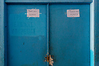 LEROS, GREECE - FEBRUARY 07: A message written by a refugee thanking Europe and Greece is hang on a door inside the Pikpa shelter on February 07, 2015 in Leros, Greece. Several shelters run by volunteers are set up across Leros Islands. Photo: © Omar Havana. All Rights Are Reserved