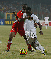 Photo: Steve Bond/Richard Lane Photography.<br />Ghana v Namibia. Africa Cup of Nations. 24/01/2008. Sulley Muntari (R) is grappled