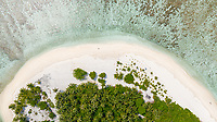 Aerial view of local island Omadhoo, located in Alif Dhaal Atoll, Maldives, Indian Ocean with reef, local beach and sandbank