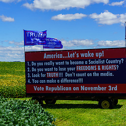 Strasburg, PA, USA - August 30, 2020: A corn wagon converted into a political billboard sits in a rural Lancaster County farmer's field.