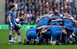 France's Maxime Machenaud (left) and Scotland's Greg Laidlaw (second left) during a scrum in the NatWest 6 Nations match at BT Murrayfield, Edinburgh.