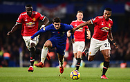 Alvora Morata of Chelsea ©  is chased down by Antonio Valencia ® and Eric Bailey (l) of Manchester United .Premier league match, Chelsea v Manchester United at Stamford Bridge in London on Sunday 5th November 2017.<br /> pic by Andrew Orchard sports photography.