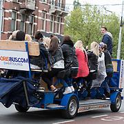 NLD/Amsterdam/20150516 - Bierfietsen door de straten van Amsterdam, vaak gebruikt voor vrijgezellenfeestjes krijgen steeds meer tegenstand
