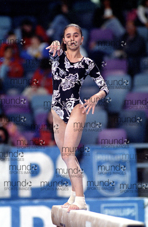 (Ottawa, Canada---16 May 1997)  competes in the balance beam at the 1997 Canadian Gymnastics Championships. Photograph copyright Sean Burges / Mundo Sport Images, 1997. www.mundosportimages.com