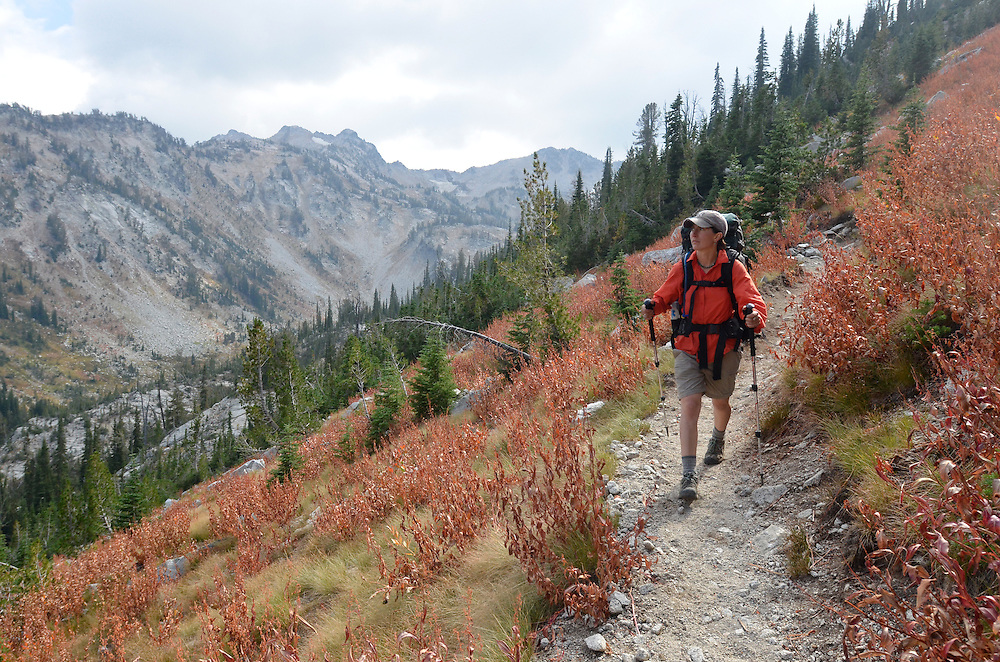 Woman hiking down a trail on a backpack trip in Oregon's Wallowa Mountains.