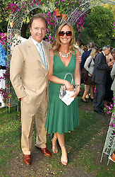 HUGO SWIRE MP and his wife at the Concervative Party Summer Party held in the gardnes of The Royal Hospital, Chelsea, London on 3rd July 2006.<br /><br />NON EXCLUSIVE - WORLD RIGHTS