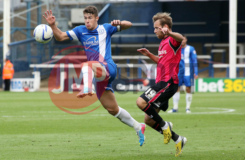 Peterborough United's Tommy Rowe in action with Oldham Athletic's James Dayton  - Photo mandatory by-line: Joe Dent/JMP - Tel: Mobile: 07966 386802 17/08/2013 - SPORT - FOOTBALL - London Road Stadium - Peterborough -  Peterborough United V Oldham Athletic - Sky Bet League One