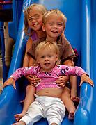 Children On The Slide Together At The Park