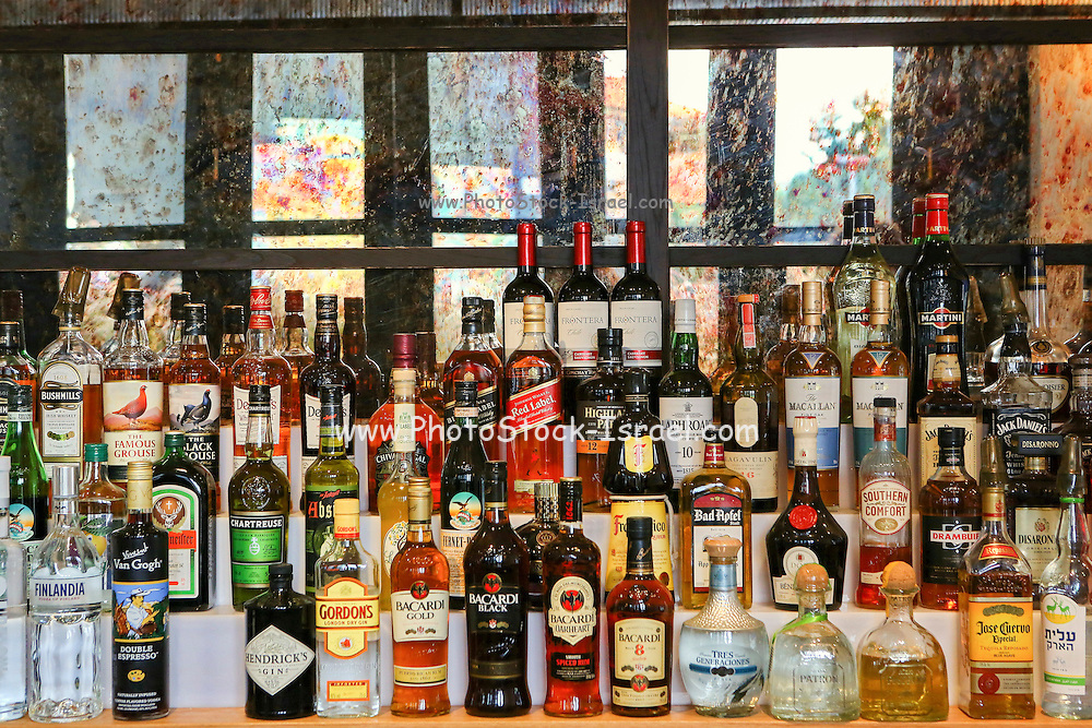 Bottles of alcohol in a well stacked bar