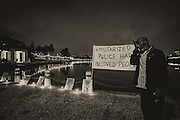 Mourners gather for a vigil remembering those killed by police officers at The Pergola at Lake Merritt.