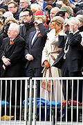 De historische landing van prins Willem Frederik, de latere Koning Willem I, die op het strand van Scheveningen wordt nagespeeld in het kader van de viering van 200 jaar koninkrijk<br /> <br /> The historic landing of Prince Willem Frederik, later King William I, on the beach of Scheveningen is re-enacted in the context of the celebration of 200 years kingdom<br /> <br /> Op de foto / On the photo:  Koning Willem-Alexander en koningin Maxima op het strand en kijken naar een helikopter van de Koninklijke Marine, koningin Maxima krijgt daardoor zand in haar ogen <br /> <br /> King Willem-Alexander and Maxima queen on the beach and watch a helicopter of the Royal Navy, Queen Maxima will therefore sand in her eyes