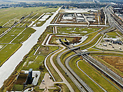 Nederland, Zuid-Holland, Gemeente Leiderdorp, 20-02-2012; Zicht op de Bospolder met ingang boortunnel onder het Groene Hart van de hogesnelheidslijn (HSL-Zuid). Het bedieningsgebouw van de tunnel, voorbeeld 'landschappelijke inpassing'. Rechts tankstation Aurora aan de A4..View of the Bospolder with entrance to the drilled tunnel of the High Speed ​​Line (HSL) under so-called the Green Heart. The control building of the tunnel, example of 'landscaping'.luchtfoto (toeslag), aerial photo (additional fee required).copyright foto/photo Siebe Swart