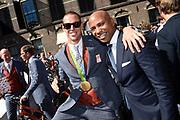 Medaillewinnaars van de Olympische Zomerspelen 2016 vertrekken per fiets van het Binnenhof voor een ontvangst op Paleis Noordeinde. <br /> <br /> op de foto:  Dorian van Rijsselberghe, goud bij zeilen in de RS:X-klasse met Humberto Tan