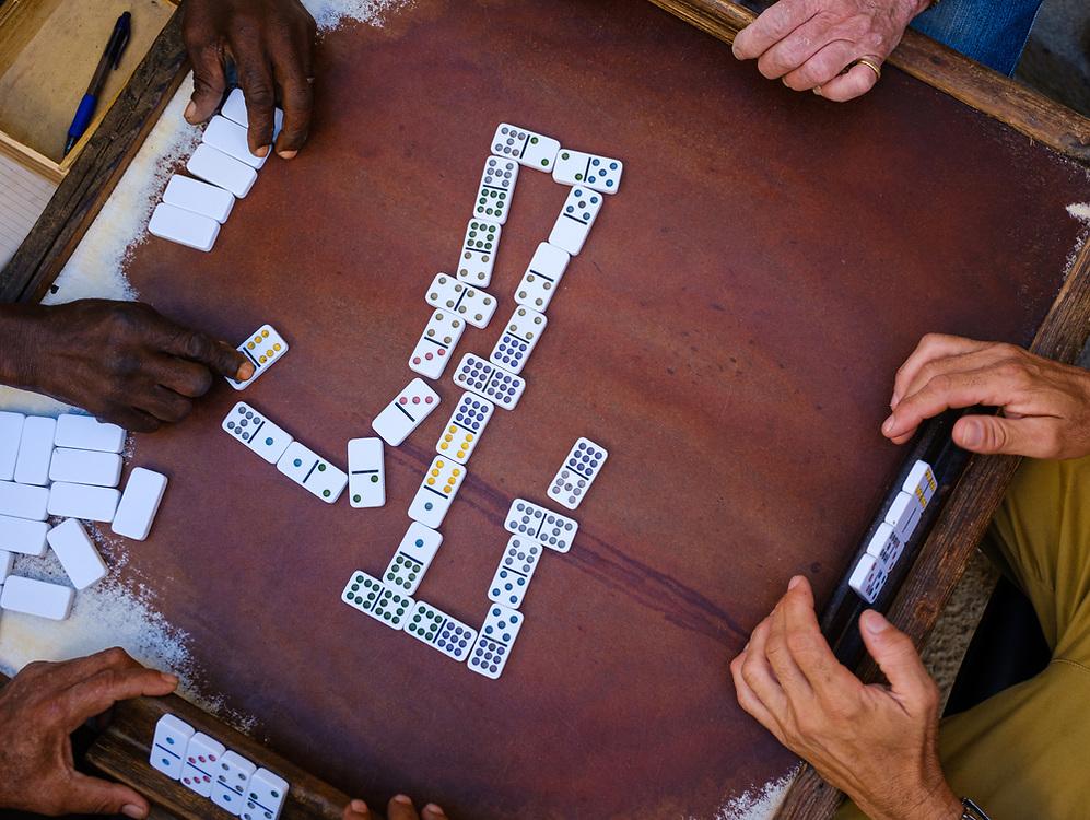 HAVANA, CUBA - CIRCA JANUARY 2020: Hands of people playing Dominoes in the streets of Havana.