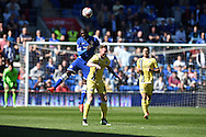 Cardiff's Bruno Ecuele-Manga climbs above Millwall's Aiden O'Brien to win a header.  Skybet football league championship, Cardiff city v Millwall at the Cardiff city stadium in Cardiff, South Wales on Saturday 18th April 2015<br /> pic by Andrew Orchard, Andrew Orchard sports photography.