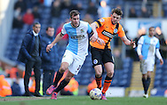 Tommy Spurr, Blackburn Rovers defender and Dale Stephens, Brighton midfielder during the Sky Bet Championship match between Blackburn Rovers and Brighton and Hove Albion at Ewood Park, Blackburn, England on 21 March 2015.