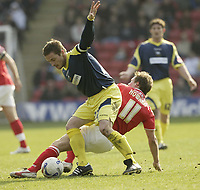 Photo: Aidan Ellis.<br /> Barnsley v Derby County. Coca Cola Championship. 31/03/2007.<br /> Derby's Matt Oakley holds of the challenge from Barnsley's Brian Howard
