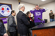 DES MOINES, IA - FEBRUARY 24: New York Mayor Bill De Blasio puts on a t-shirt for the Asian & Latino Coalition after speaking to their members Sunday, Feb. 24, 2019, at the International Association of Machinists and Aerospace Workers Union hall in Des Moines, Iowa. Scott Morgan for The New York Times