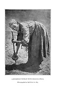 Bushman woman with digging stick Photographed in Salt River in 1884 From the book '  Specimens of Bushman folklore ' by Bleek, W. H. I. (Wilhelm Heinrich Immanuel), Lloyd, Lucy Catherine, Theal, George McCall, 1837-1919 Published in London by  G. Allen & Company, ltd. in 1911. The San peoples (also Saan), or Bushmen, are members of various Khoe, Tuu, or Kx'a-speaking indigenous hunter-gatherer groups that are the first nations of Southern Africa, and whose territories span Botswana, Namibia, Angola, Zambia, Zimbabwe, Lesotho and South Africa.