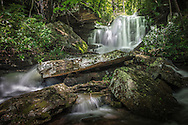 At the top of one of the most popular waterfalls in West Virginia lies another waterfall rarely seen or visited, nestled comfortably within stacks of large slabs of rock and lush green rhododendron.