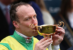 Jockey Robbie Power celebrates with the trophy after his winning ride on Sizing John in the Timico Cheltenham Gold Cup Chase during Gold Cup Day of the 2017 Cheltenham Festival at Cheltenham Racecourse.