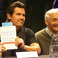 """Josh Brolin holds a copy of Howard Zinn's """"People's History of the United States"""" as Zinn looks on at a Boston press conference at Cutler Majestic Theatre. Photo by Mark Garfinkel"""