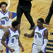 ORLANDO, FL - APRIL 12: Devin Cannady #30, Robert Franks #0 and Karim Mane #4 of the Orlando Magic walk off the court after a game against the San Antonio Spurs at Amway Center on April 12, 2021 in Orlando, Florida. NOTE TO USER: User expressly acknowledges and agrees that, by downloading and or using this photograph, User is consenting to the terms and conditions of the Getty Images License Agreement. (Photo by Alex Menendez/Getty Images)*** Local Caption *** Devin Cannady; Robert Franks; Karim Mane