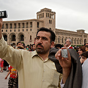 People make pictures with their mobile phones in Yerevan, the capital of Armenia.