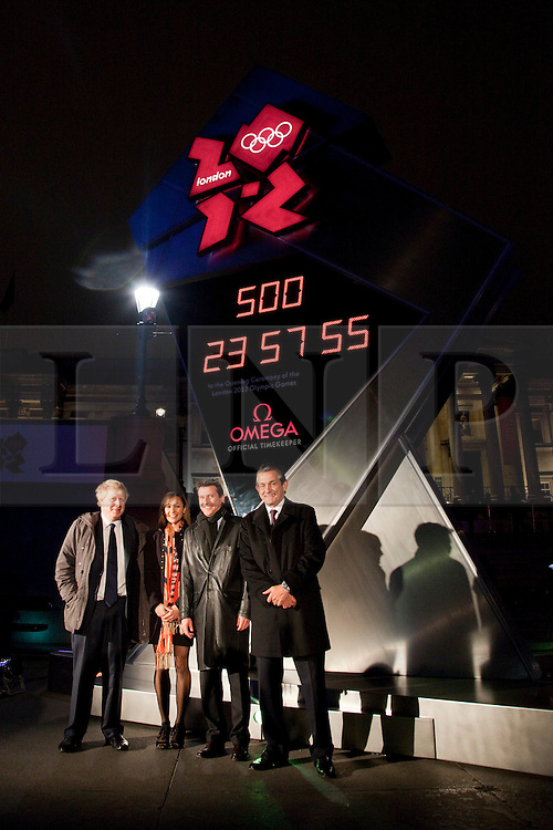 © under license to London News Pictures. 14/03/2011. Unveiling ceremony of Omega Olympic Games countdown clock. The clock is in London's Trafalgar Square and will remain until the opening of the 2012 games.(from left) London Mayor Boris Johnson, Heptathlete Jessica Ennis, chairman of the London Organising Committee for the Olympic Games Lord Sebastian Coe and Omega President Stephen Urquart. Photo credit should read BETTINA STRENSKE/LNP