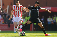 Stoke's Ryan Shawcross battles for the ball with Liverpool's Emre Can. Premier league match, Stoke City v Liverpool at the Bet365 Stadium in Stoke on Trent, Staffs on Saturday 8th April 2017.<br /> pic by Bradley Collyer, Andrew Orchard sports photography.
