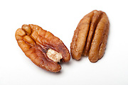 shelled Pecan Nuts (Carya illinoensis) On white Background