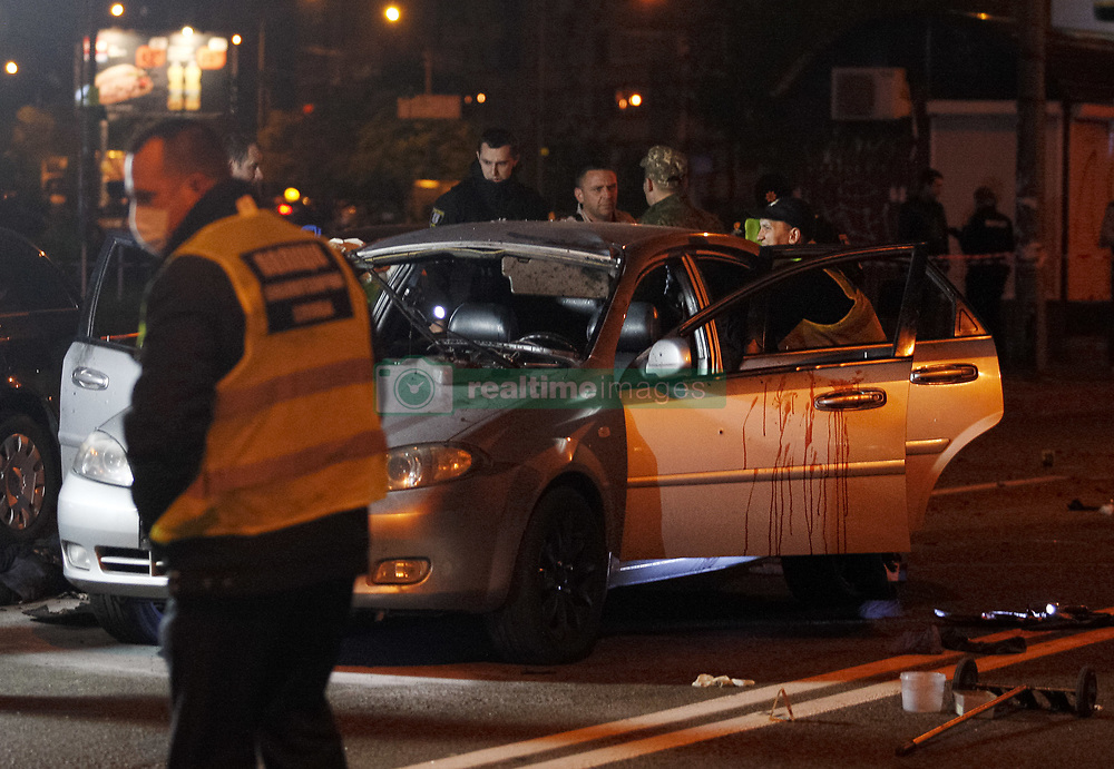 April 27, 2018 - Kiev, Ukraine - Police experts investigate the scene of a grenade explosion within a car, in Kiev, Ukraine, 28 April 2018. One unidentified man was killed and another one injured after a grenade exploded inside of a car, as local media reported. (Credit Image: © Str/NurPhoto via ZUMA Press)