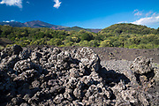 Lava field caused by volcanic eruption of Mount Etna an active stratovolcano on the east coast at Taormina, Sicily, Italy