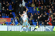 West Ham's Mark Noble ® celebrates with Andy Carroll after he scores his sides 2nd goal. Barclays Premier league, Cardiff city v West Ham Utd match at the Cardiff city Stadium in Cardiff, South Wales on Saturday 11th Jan 2014.<br /> pic by Andrew Orchard, Andrew Orchard sports photography.
