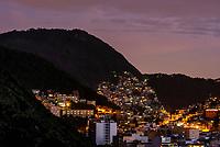 Favelas (slums) seen predawn, dot hillsides around Rio de Janeiro, Brazil.