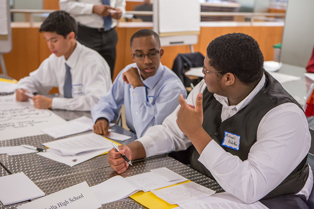 Purchase, NY – 31 October 2014. Valhalla High School team members (left to right) Alec Uy, Tyler Wills, and Michael Nduka discuss their case. The Business Skills Olympics was founded by the African American Men of Westchester, is sponsored and facilitated by Morgan Stanley, and is open to high school teams in Westchester County.