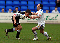 Photo: Paul Greenwood.<br />Tranmere Rovers v Swansea City. Coca Cola League 1. 10/03/2007.<br />Swansea's Pawel Abbott, (L) bravely heads past the challenge of Chris Shuker