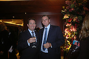 Liam Fox and Lord Ashcroft. 'Dirty politics, Dirty times: My fight with Wapping and New Labour' by Michael Ashcroft. Book launch party in aid of Crimestoppers. Riverbank Plaza Hotel. London SE1.      October 10 2005. ONE TIME USE ONLY - DO NOT ARCHIVE © Copyright Photograph by Dafydd Jones 66 Stockwell Park Rd. London SW9 0DA Tel 020 7733 0108 www.dafjones.com