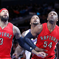 27 December 2014: Los Angeles Clippers forward Glen Davis (0) vies for the rebound with Toronto Raptors forward James Johnson (3) and Toronto Raptors forward Patrick Patterson (54) during the Toronto Raptors 110-98 victory over the Los Angeles Clippers, at the Staples Center, Los Angeles, California, USA.