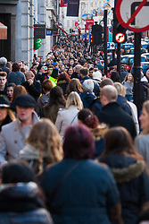 """London, December 20th 2014. Tens of thousands of shoppers descend on central London to scoop up pre-Christmas bargains as retailers offer discount incentives on """"Panic Saturday"""". PICTURED: Crowds pack Regents Street."""